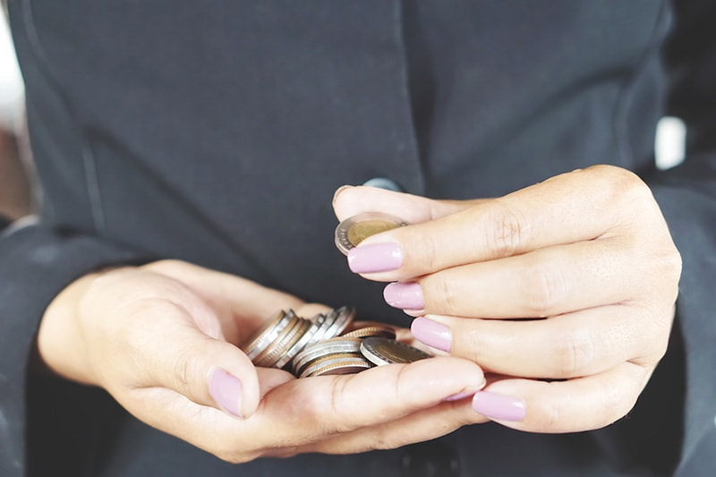 woman counting coins pink fingernails,How Can I Afford a New AC System (and Other HVAC Equipment)?